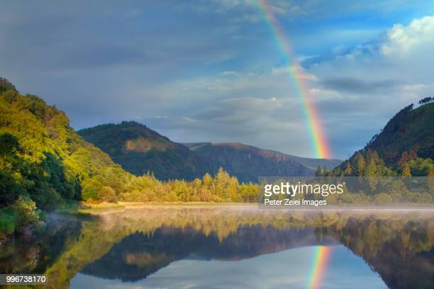 the lower lake in glendalough, county wicklow, ireland - rainbow stock pictures, royalty-free photos & images