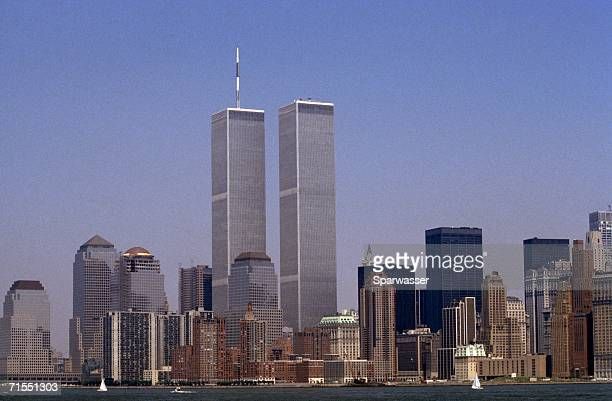 the lower manhattan skyline featuring the world trade center, new york city, usa - on this day september 11 attacks stock pictures, royalty-free photos & images