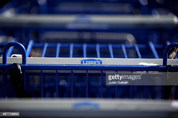 The Lowe's logo is displayed on a shopping cart at a Lowe's home improvement store on November 18 2015 in South San Francisco California Lowe's...