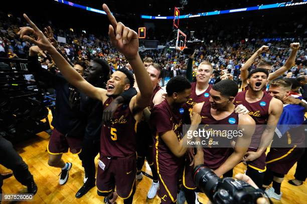 The Loyola Ramblers celebrate after defeating the Kansas State Wildcats during the 2018 NCAA Men's Basketball Tournament South Regional at Philips...