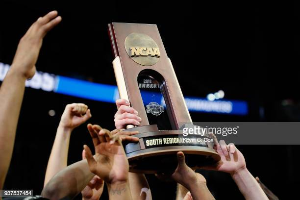 The Loyola Ramblers celebrate with the trophy after defeating the Kansas State Wildcats during the 2018 NCAA Men's Basketball Tournament South...