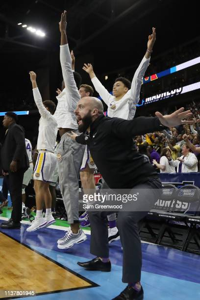 The LSU Tigers bench celebrates as they take on the Maryland Terrapins during the second half of the game in the second round of the 2019 NCAA Men's...