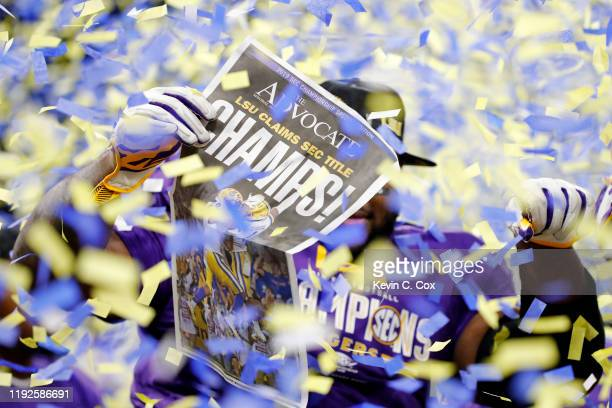 The LSU Tigers celebrate after defeating the Georgia Bulldogs 3710 to win the SEC Championship game at MercedesBenz Stadium on December 07 2019 in...