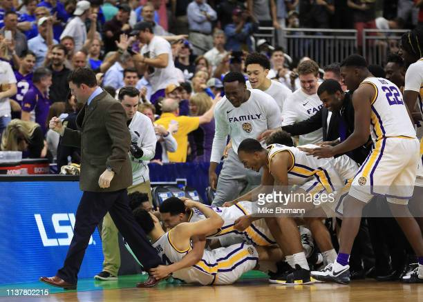 The LSU Tigers celebrate1 their 6967 win over the Maryland Terrapins in the second round of the 2019 NCAA Men's Basketball Tournament at Vystar...