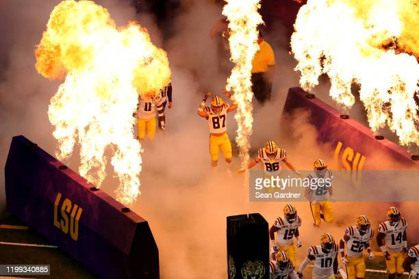 The LSU Tigers run onto the field prior to the start of the game against the Clemson Tigers in the College Football Playoff National Championship...