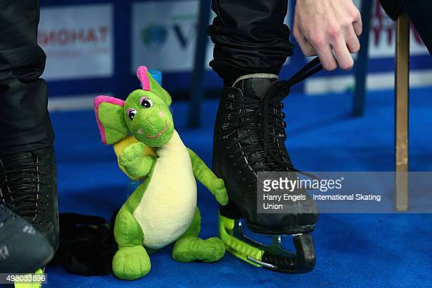 The lucky toy of Sergei Voronov of Russia is seen as he unties his ice skates after skating during the Men's Short Program on day one of the...