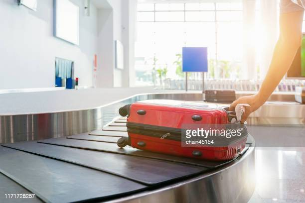 the luggage on the belt in an airport for travelling to tourist destination around the world - luggage stock pictures, royalty-free photos & images
