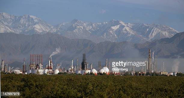 The Lujan de Cuyo Repsol YPF SA oil refinery is seen at the foot of the Andes mountain range close to the Chilean border in the province of Mendoza...