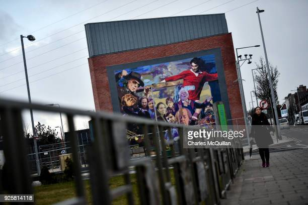 The Luminaries and Legends mural by artist Dee Craig highlighting cultural icons hailing from east Belfast including Van Morrison George Best CS...