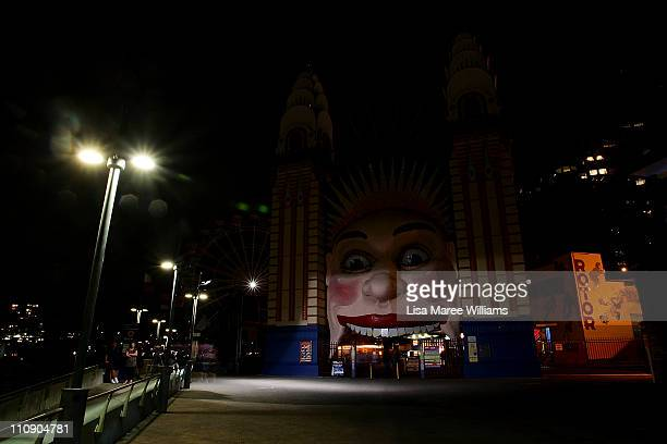The Luna Park entrance is seen after the lights are switched off for Earth Hour on March 26 2011 in Sydney Australia Earth Hour encourages...