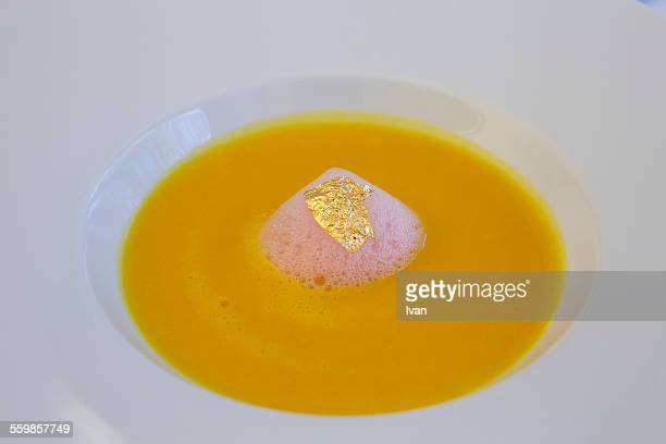 The luxury french carrot soup with goldleaf