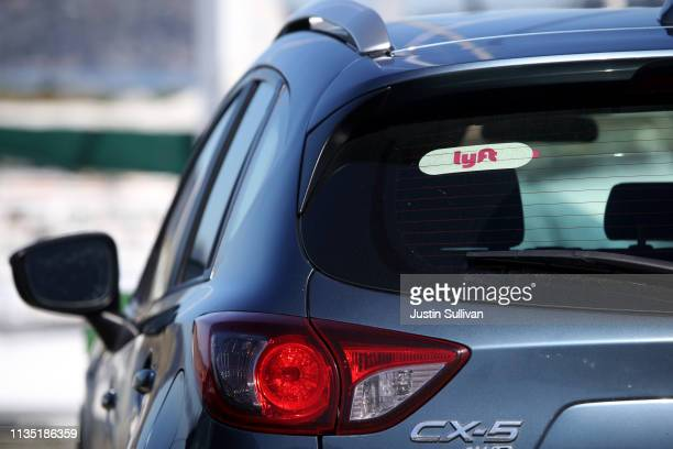 The Lyft logo is displayed on a car on March 11 2019 in San Francisco California Ondemand transportation company Lyft has filed paperwork for its...