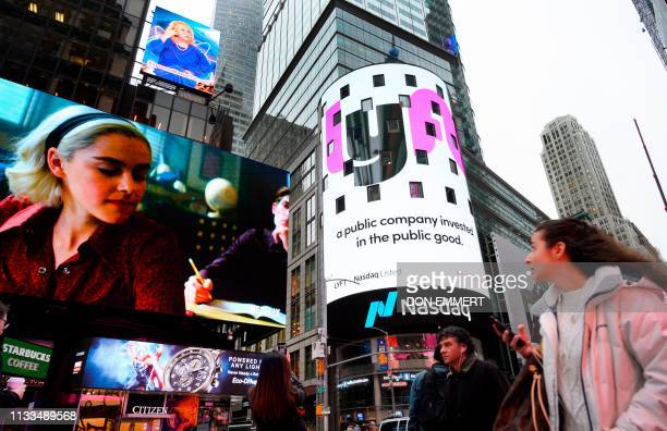 The Lyft logo is shown on the screen at the Nasdaq offices in Times Square on March 29 2019 in New York Nasdaq LYFT the multimodal transportation...
