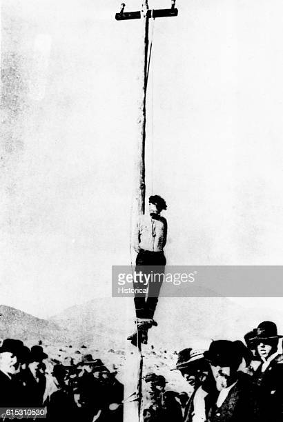 The lynching of John Heith at Tombstone, Arizona. He was implicated in the robbery of the Goldwater-Castaneda store in December 1883, during which...