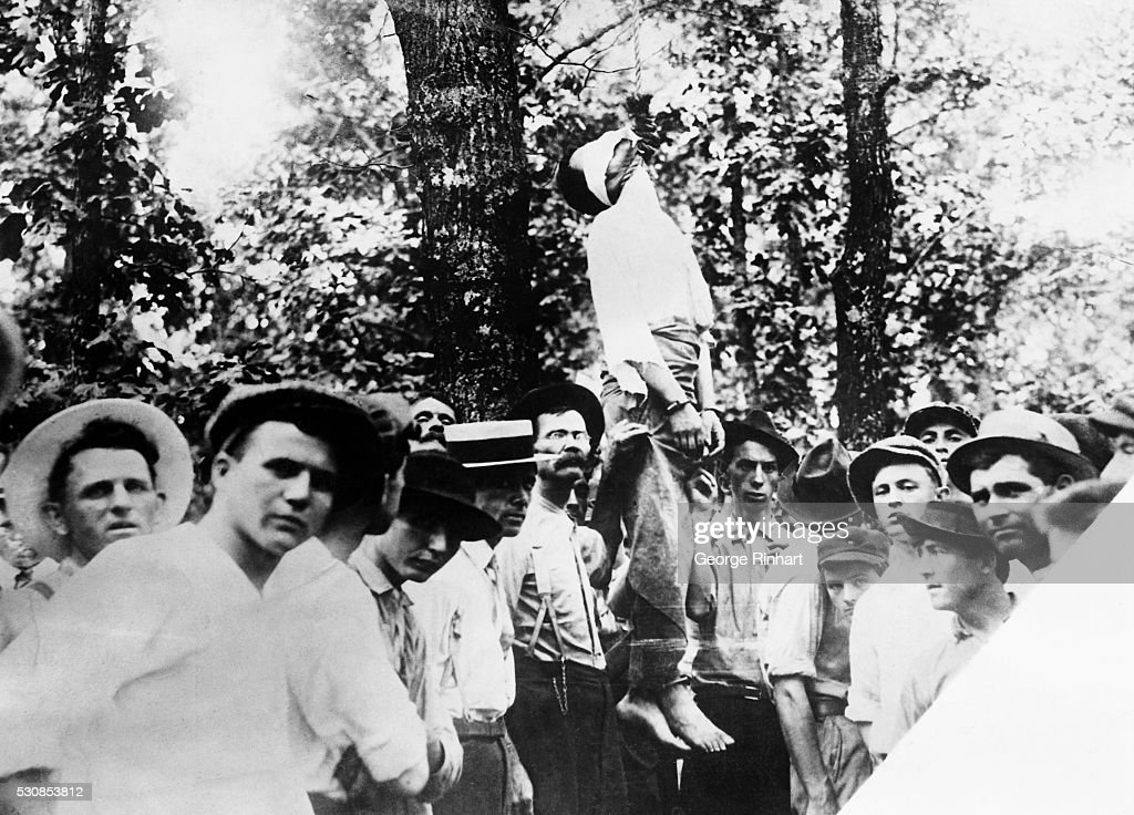 Mob Standing Around Lynched Corpse : News Photo