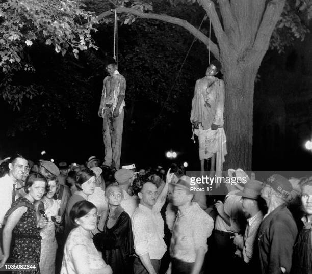 The lynching of Thomas Shipp and Abram Smith The AfricanAmericans were arrested as suspects accused for robbery murder and rape An angry mob broke...