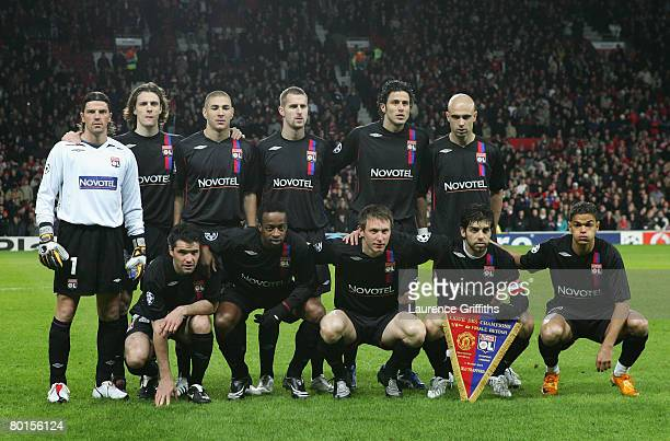 The Lyon players line up for a team photo prior to the UEFA Champions League first knockout round second leg match between Manchester United and Lyon...