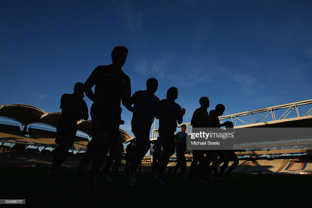 The Lyon squad warm up during the Olympic Lyon Training session, ahead of their Group B UEFA Champions League first phase match against Schalke 04, at Stade de Gerland on September 13, 2010 in Lyon, France.