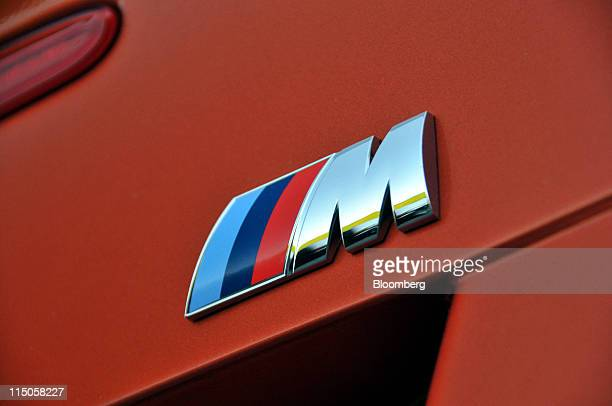 The M performance division logo of the 2011 BMW 1M coupe is seen near Monticello New York US on Tuesday May 10 2011 Powered by a 335horsepower twin...