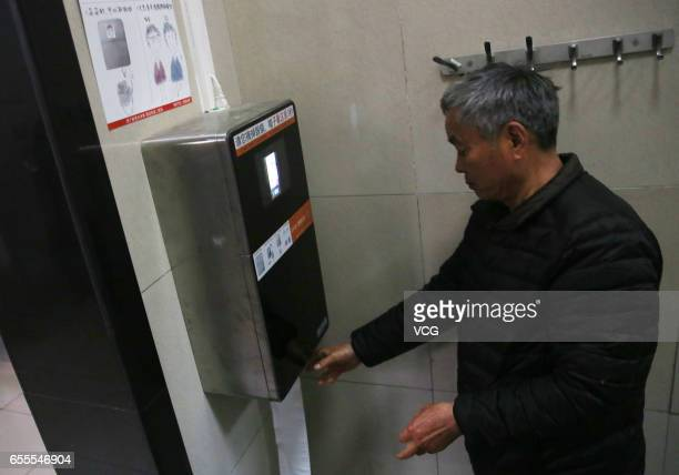 The machine recognizes a man's face to give out toilet paper automatically at a toilet in the park of the Temple of Heaven on March 20 2017 in...