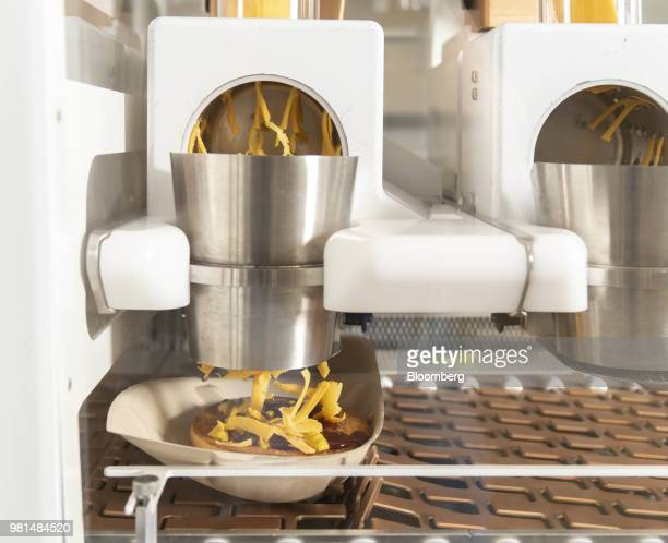 Refrigerators stand next to the machine at the Creator storefront in San Francisco California US on Monday June 18 2018 On June 27 the world's first...