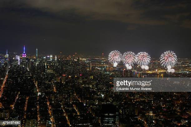 The Macy's 4th of July Fireworks explode along the East River from the One World Trade Center Observatory on July 4 2015 in New York City