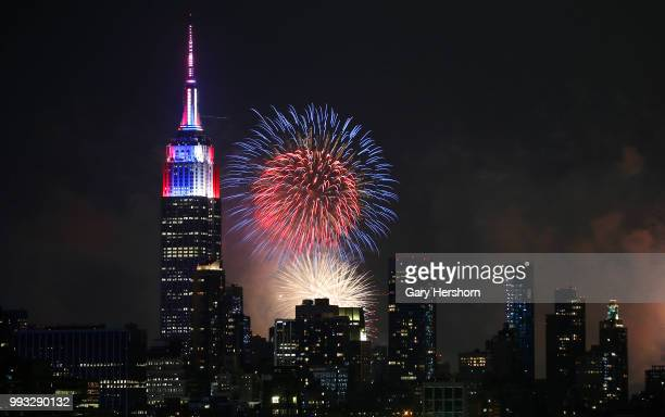 The Macy's Fourth of July fireworks show lights up the sky over midtown Manhattan and the Empire State Building in New York City on July 4 2018 as...