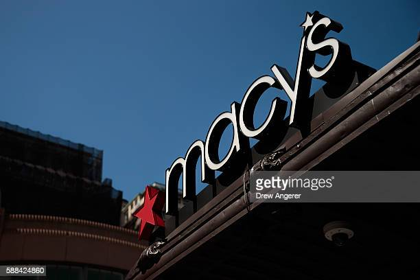 The Macy's sign hangs over its flagship store in Herald Square August 11 2016 in New York City On Thursday Macy's announced plans to close 100 stores...