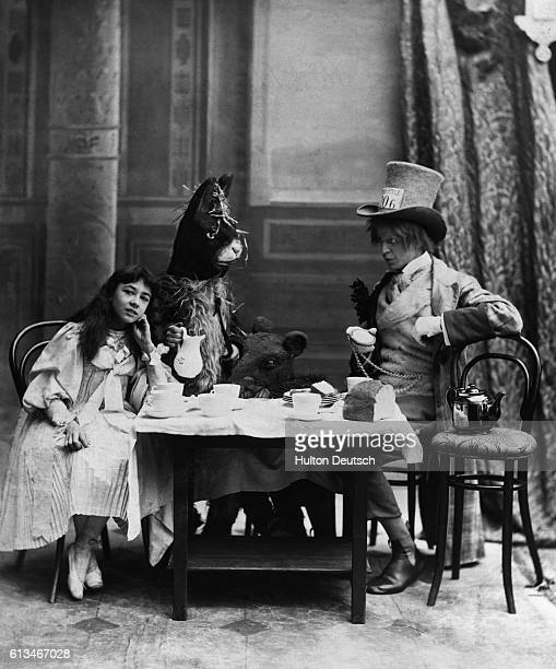 The Mad Hatter the March Hare and Alice at the Mad Hatter's tea party from Alice in Wonderland by Lewis Carroll