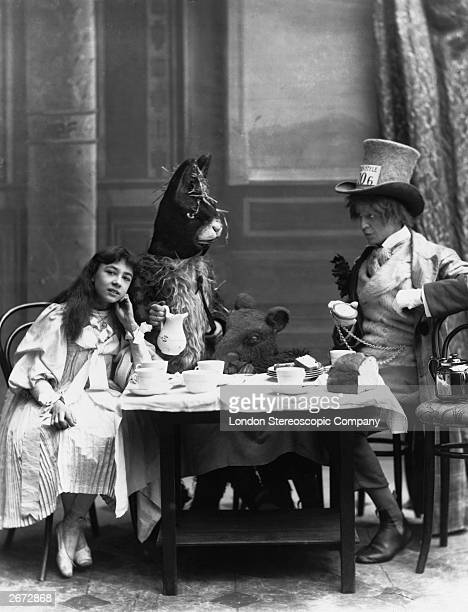 The Mad Hatter's Tea Party from 'Alice in Wonderland' with Rosa Hersee as Alice and Arthur Elliot as the Hatter at the Opera Comique Theatre in London