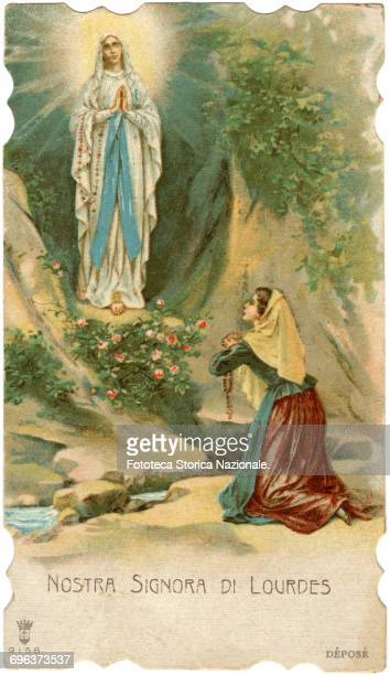 The Madonna appears in the cave and Bernadette on her knees contemplates ecstatic the apparition The visions were eighteen and took place between 11...