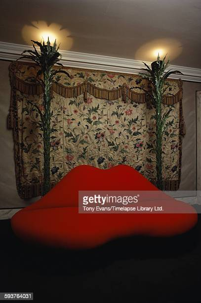 The Mae West Lips Sofa by Salvador Dali in Monkton House part of the West Dean Estate in West Sussex 1972 It was refurbished by British poet Edward...