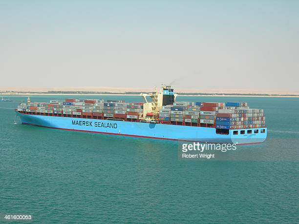 """The Maersk Line container ship """"Maersk Washington"""" sits moored in the Suez Canal's Great Bitter Lake during a southbound transit of the canal on..."""