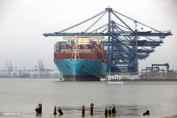 The Maersk Madrid container ship operated by AP MollerMaersk A/S sits docked during cargo unloading at the Port of Felixstowe Ltd a subsidiary of CK...