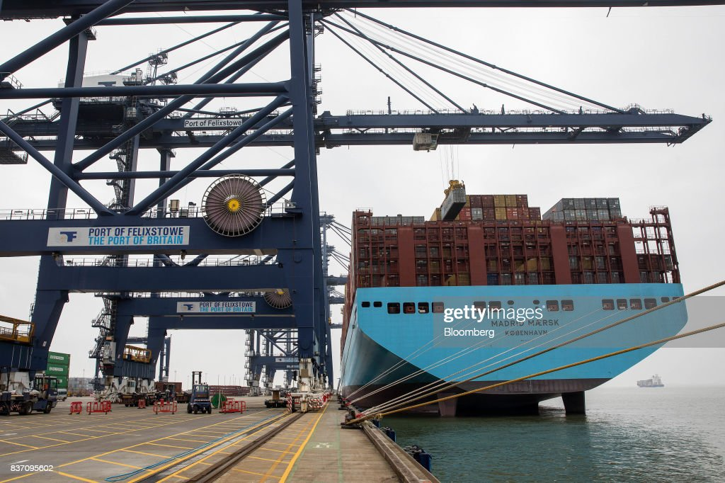 The Maersk Madrid container ship, operated by A.P. Moller-Maersk A/S, sits docked at the Port of Felixstowe Ltd., a subsidiary of CK Hutchison Holdings Ltd. in Felixstowe, U.K., on Tuesday, Aug. 22, 2017. U.K. exporters are still reaping the benefits of a weaker pound, but they're not sure how long the boost will continue as the country gets closer to withdrawing from the European Union. Photographer: Simon Dawson/Bloomberg via Getty Images