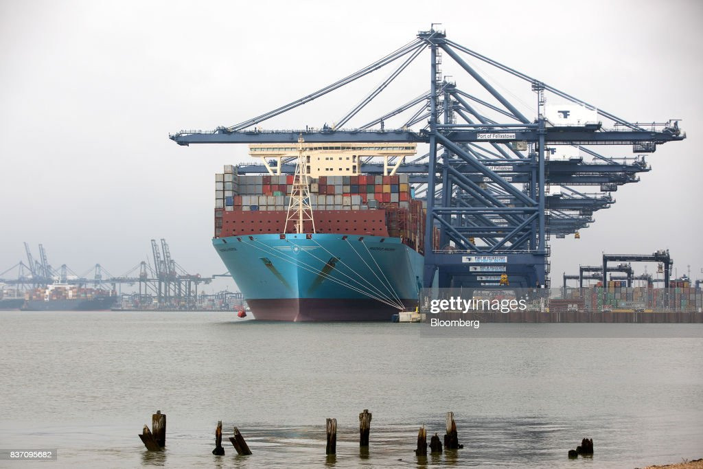 The Maersk Madrid container ship, operated by A.P. Moller-Maersk A/S, sits docked during cargo unloading at the Port of Felixstowe Ltd., a subsidiary of CK Hutchison Holdings Ltd. in Felixstowe, U.K., on Tuesday, Aug. 22, 2017. U.K. exporters are still reaping the benefits of a weaker pound, but they're not sure how long the boost will continue as the country gets closer to withdrawing from the European Union. Photographer: Simon Dawson/Bloomberg via Getty Images