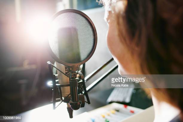 the magic happens behind the mic - radio stock pictures, royalty-free photos & images