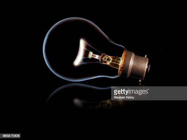 the magical light bulb - lampara de aladino fotografías e imágenes de stock