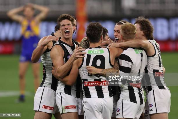 The Magpies celebrate winning the AFL First Elimination Final match between the West Coast Eagles and the Collingwood Magpies at Optus Stadium on...