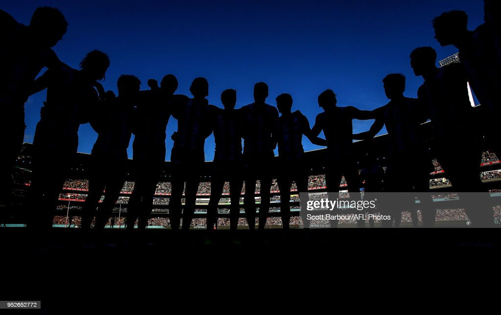 The Magpies form a team huddle during the 2018 AFL round six match between the Collingwood Magpies and the Richmond Tigers at the Melbourne Cricket Ground on April 29, 2018 in Melbourne, Australia.