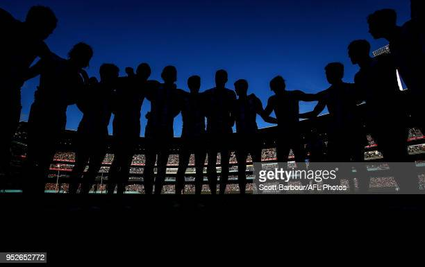 The Magpies form a team huddle during the 2018 AFL round six match between the Collingwood Magpies and the Richmond Tigers at the Melbourne Cricket...