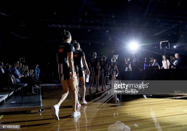 The Magpies make their way onto the court for the round 10 Super Netball match between the Magpies and the Firebirds at the Silverdome on April 30...