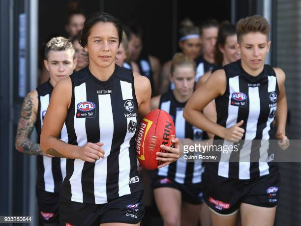 The Magpies run out onto the ground during the round seven AFLW match between the Collingwood Magpies and the Adelaide Crows at Olympic Park on March...