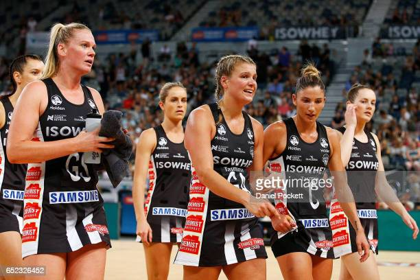 The Magpies walk from the court at half time during the round four Super Netball match between the Magpies and the Thunderbirds at Hisense Arena on...