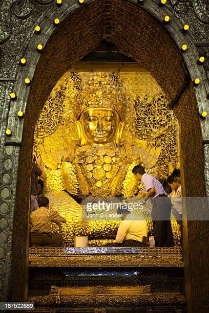 The Mahamuni Buddha Temple is a Buddhist temple and major pilgrimage site in Mandalay Burma The Mahamuni Buddha image is deified in this temple and...