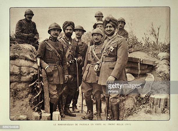 The maharaja / maharajah of Patiala India visiting trench with officers in Flanders during the First World War Belgium