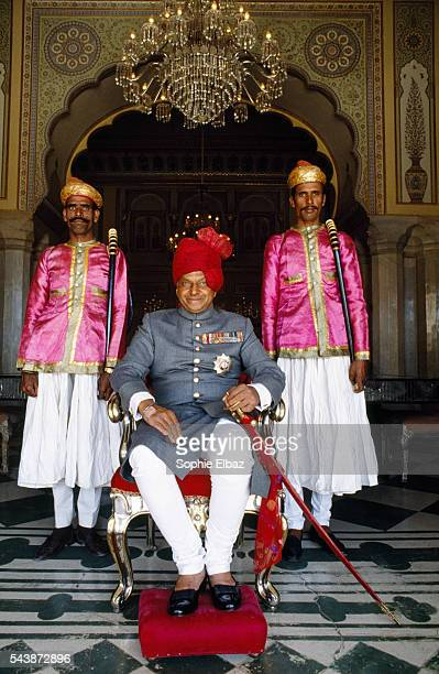 The Maharaja of Jaipur Bhawani Singh head of the Royal house of Jaipur is flanked by guards wearing traditional uniforms dating back to the 18th...