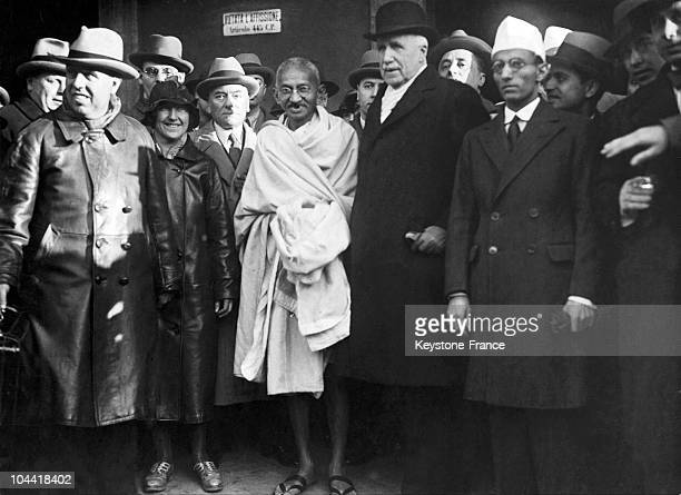 The Mahatma GANDHI surrounded by Italian celebrities and figures in Rome in the 1940's