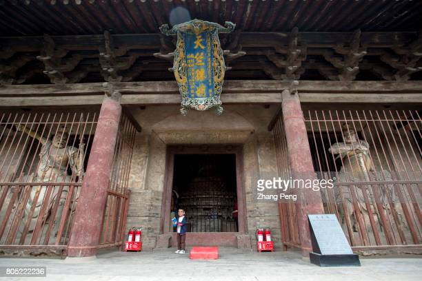 The Mahavira Hall The Shuanglin Temple is famous for more than 2000 colorful well preserved sculptures left from the Song Yuan Ming and Qing...