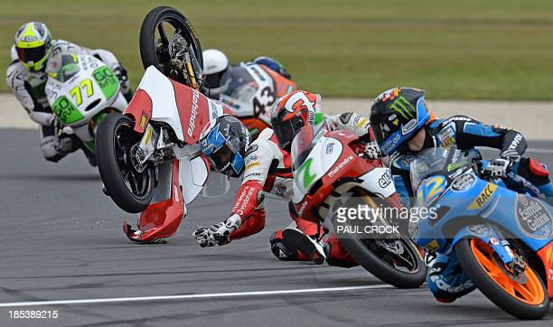 The Mahindra Racing bike of rider Miguel Oliveira of Portugal flies through the air as he crashes during the Moto3 race at the Australian Grand Prix...